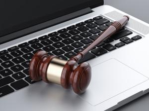 wooden gavel on laptop